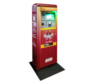 Photo of VenTek fare vending machine. FVM is burgundy in color with Artie's image printed on the front.